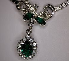 Sterling silver beautiful necklace with Tourmaline color and colorless stones. Very nice state.