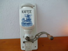 Coffee grinder with porcelain container