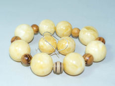 Set of Baltic amber bracelet with wood beads and amber earrings with silver plated white/yellow colour, 39 gram