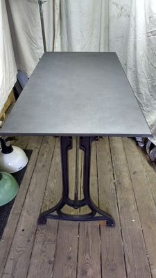 Cast iron table with metal tabletop