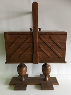 Wooden fold-out trapeze model sewing chest, ca. 1930