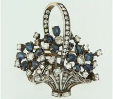 Silver brooch in the shape of a flower basket, set with sapphire and diamond