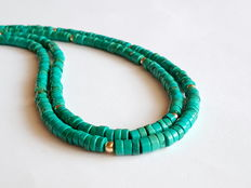 Necklace made of turquoise beads, 2 roes, with 14 kt yellow gold clasp and in between beads