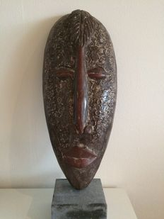 African wooden mask with fittings