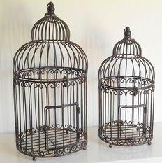 A set of brocante bird cages