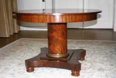 A mahogany Empire extendable dining-table - with two connecting pieces - the Netherlands - circa 1815/1820