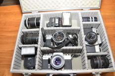 Beautiful aluminium photo case with 3 Praktica 35 mm SLR cameras, 3 extra lenses, 2 flash units and extension rings. Everything in good condition and working.