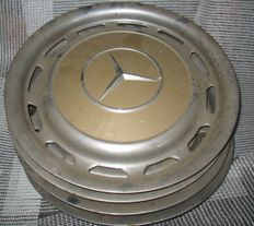 Mercedes Benz - 4 wheel covers for 14 inch wheel rims