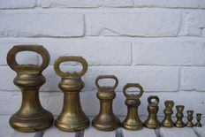 A set of 9 calibrated Bell or stool weights - England - ca. 1910