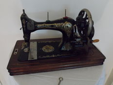 Graamans hand sewing machine with wooden cover, Germany, ca. 1910