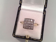 Yellow and white gold ring of 18 karat with 16 brilliant cut diamonds, 0.64 ct in total