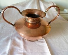 Old pot in hammered copper with handles