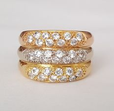 18 kt three-colour gold in a triple ring design, set with zirconias.