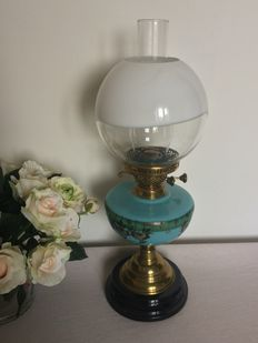 An opaline glass and brass oil lamp, England, late 19th century.