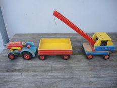 Lot with an old wooden tractor with trailer and a crane  - from the 60s
