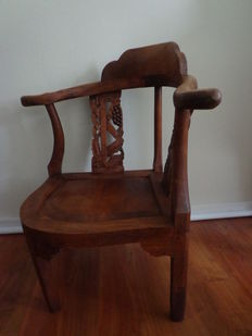 Wooden chair with wood carving