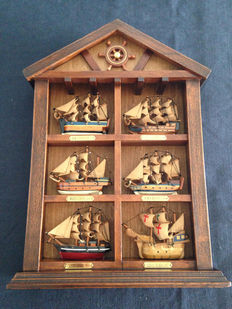 Antique artwork made of boats that marked history, in oak wood