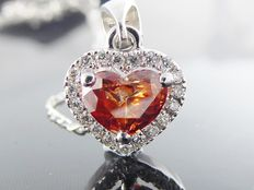 White gold pendant with an intense fancy deep red heart-shaped diamond of 0.75 ct & 18 diamonds of 0.90 ct in total