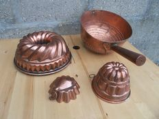 Three copper cake shapes with tinned insides. And a copper colander