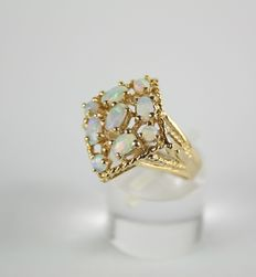 Gold ring made of 14 kt yellow gold with natural opals