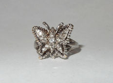 Magnificent Butterfly Ring in white gold set with 17 Diamonds.