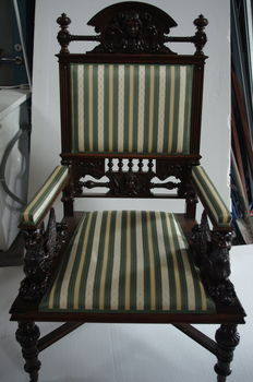 A pair of richly carved cherry wood armchairs, Renaissance style, end of 19th century
