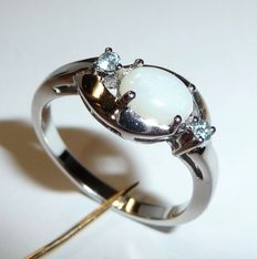 Ring with natural white full opal and 2 small aquamarines in white gold