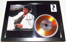 Michael Jackson /Thriller' signed( facsimile )photo and gold disc effect presentation.