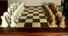 Resin-polystone chess. Board made of noble-wood marquetry.