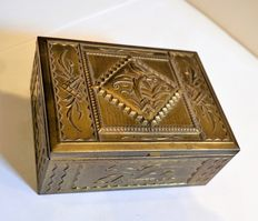 Brass art deco cigarette box with a beautifully decorated backdrop of birds and butterflies