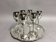 Six silver plated champagne flûtes on a silver plated round serving tray, mid 20th century