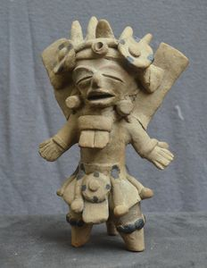 Pre-Colombian earthenware statuette representing a richly dressed Priest figure - 22.2 cm