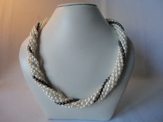 Pearl necklace with 7 strands of white / black rice freshwater pearls with a 925 silver lobster clasp.