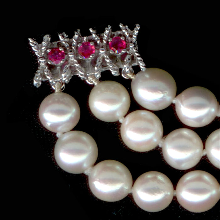 Three-row braclet with Japanese Akoya pearls 7-7.3mm with three rubies 3mm each