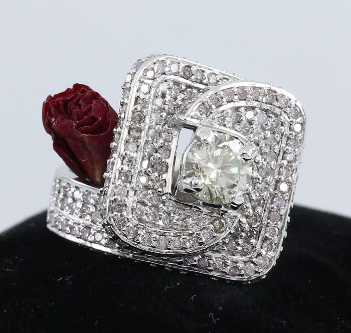White gold 1.09 ct. Center Solitaire Diamond with Side Pink diamonds of 2.28 ct. Exclusive ring design - Ring size – 55 1/4 (FR) 17.25 mm