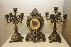 3 part heavy brass set, consisting of a clock and 2 candle holders with 5 arms.