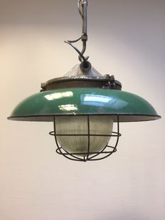 Large cast-iron industrial lamp with a green enamel shade