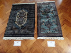 Two hand-knotted Bouchara carpets with certificate. 123 x 62 en 119 x 81