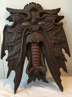 Wood carving demons head oak
