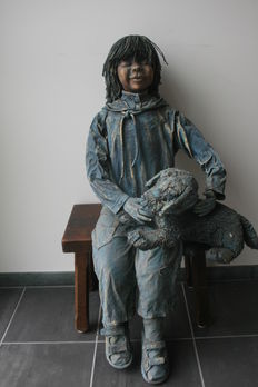 Figure of a child and dog.