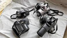 batch of four olympus cameras/ - superzoom 70-    is 100-   is 200-  az 300 superzoom-
