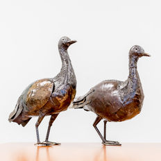 Two beautiful large geese made of metal
