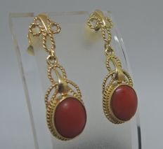 Classic, gold, two-piece earrings with oval, red corals.