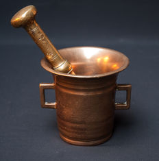 A brass mortar with accompanying pestle -Holland-18th century