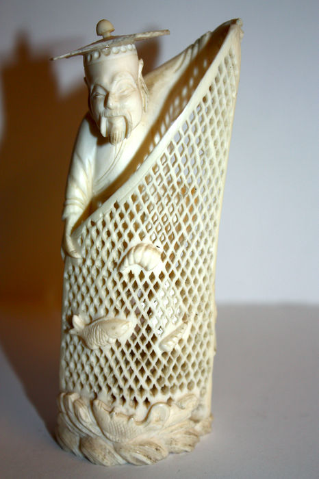 Finely carved ivory statue, of a fisherman with a fishing net - China - circa 1930
