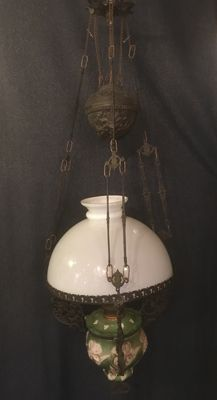 Cast iron maiolica oil lamp with opaline lamp shade, ca. 1914, France
