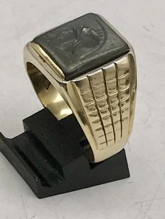 Large heavy solid men's signet ring with a cut/sculpted onyx.