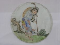 Circular porcelain plaque with traveller - China - 19th century (late Qing era)