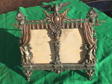 Photo frame in eclectic style of bronzed cast