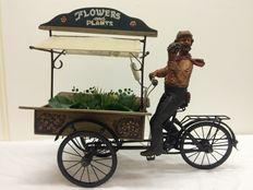 Flowers and plants carrier tricycle.